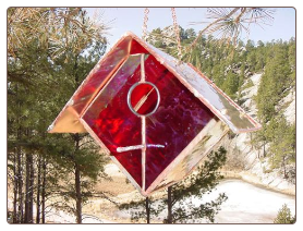 Copper and stained glass are hancrafted to crafted these unique birdhouses