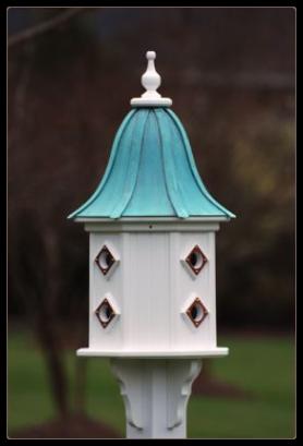 Vinyl birdhouse with copper roof