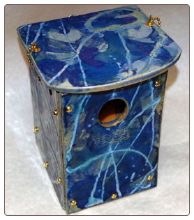 handcrafted stoneware blue bird house