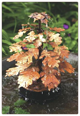 a copper leaf birdbath dripper and fountain provides a soothing sight and sound
