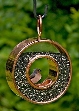 copper and glass bird feeder is quite groovy