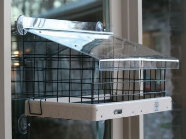 Innovative Cage Add-On Make these window bird feeders squirrel resistant