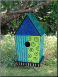 a real glass bird feeder is rare, but here's a fused glass on a wooden nest box