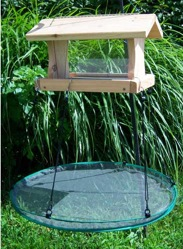 Use seed catchers to prevent ground waste and unwanted visitors