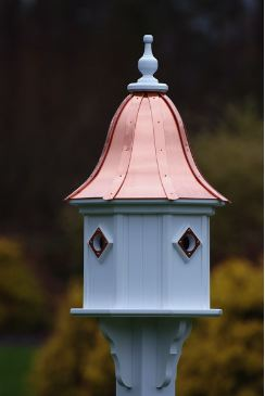 Find four entrances and matching portals on this copper roof birdhouse