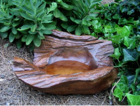 Natural materials and elements create  unique bird baths to meld with nature.