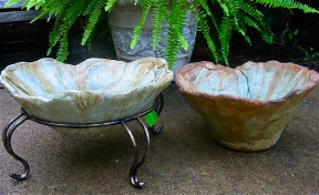 unique textured birdbath with matching planter is handcrafted from 60% recycled materials