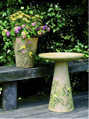 Hand painted birdbath and matching planter features perching Goldfinches