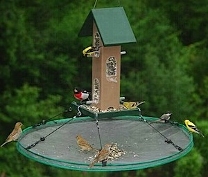 use bird seed trays at whole peanut bird feeders to minimize waste