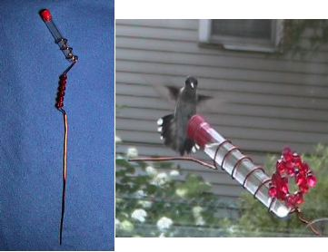 The set of two hand held feeders includes a staked and window hummingbird feeder
