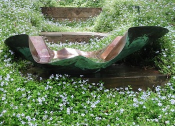 Turquoise sea glass helps trap sediments and provides contrast in this birdbath & planter
