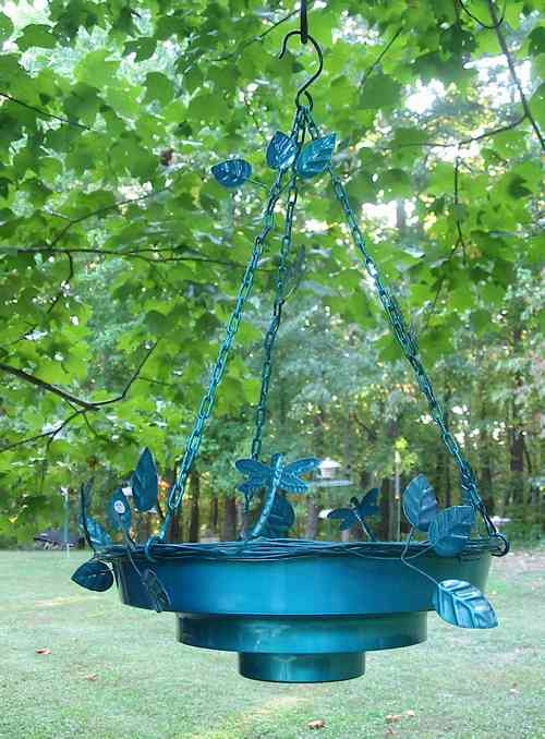 This hanging bird bath will work great in the large tree.