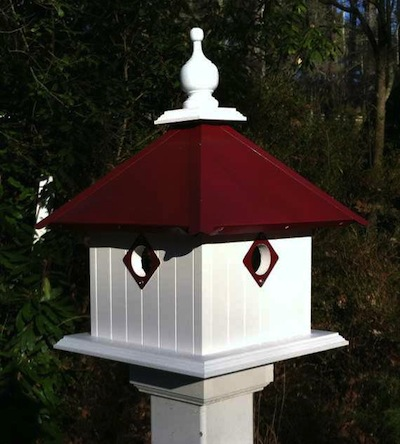 Vinyl/PVC construction and metal predator guards enhance these decorative bird houses