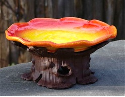 Ground birdbath doubles as fruit plate for butterflies