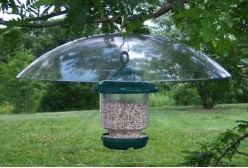 squirrel proof bird feeders that hang with a large baffle