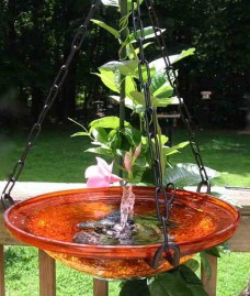 solar bubbler brings a hanging birdbath to life