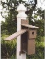 Easy blue bird house nest checks with a side door that opens