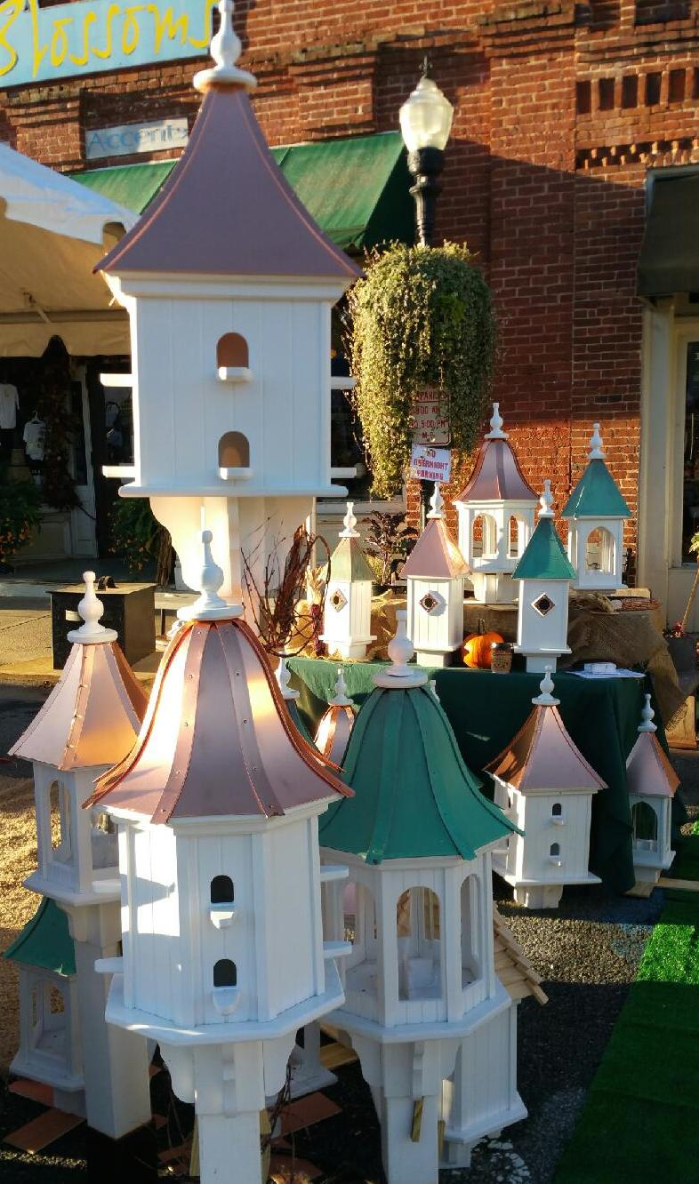 copper bird feeders and birdhouses at fall show