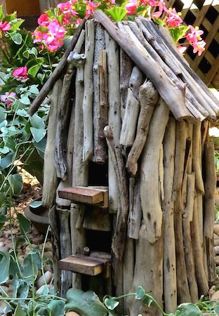 unique birdhouse crafted from driftwood